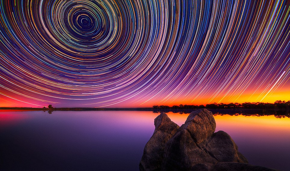 PIC BY LINCOLN HARRISON / CATERS NEWS - Photographer Lincoln Harrison was really shooting for the stars with this spectacular collection of snaps. His unrivalled pictures of star trails were taken over a period of up to 15 hours in Bendigo, Australia over the scenic Lake Eppalock. Captured using a long exposure lens, the trails are created as the Earth rotates, giving the impression of the stars moving across the sky. Lincoln, 36, bought his first camera last year to take pictures of clothes he wanted to sell on eBay. SEE CATERS COPY.